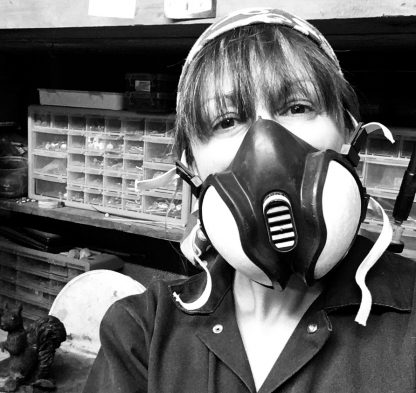 Sculptor Kirsty Armstrong wearing a breathing mask
