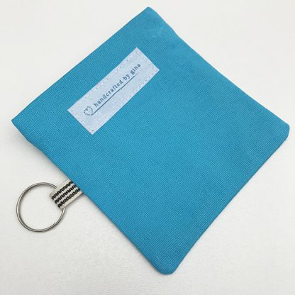 Back of turquoise earphone pouch