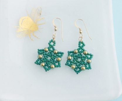 green beaded snowflake earrings with glass pearls