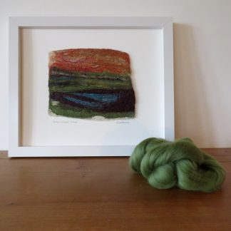 Depicts the wet felted painting entitled Autumn Sunset, Exmoor with a sample of the Merino wool used to create it.