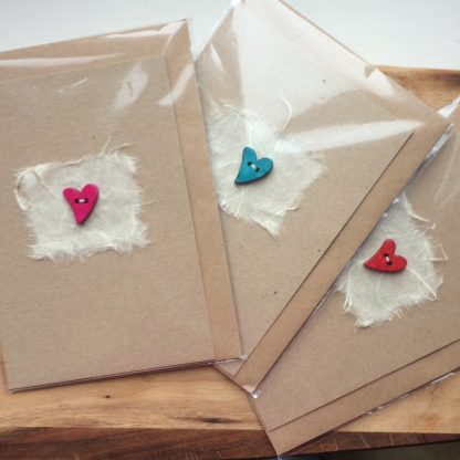 hand sewn wooden heart on mulberry paper greetings card colours