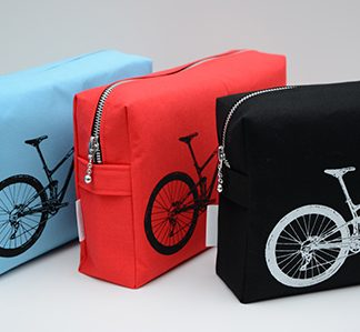 Screen printed washbags in three colours with cycle design