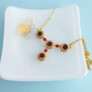 Red and gold Y shaped necklace