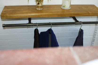 Industrial pipe clothes rail with rustic scaffold board bookshelf in oak colour