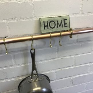 copper rail for pots and pans with hooks for British craft house