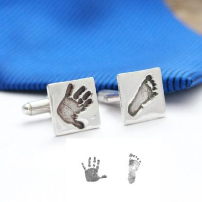 silver hand and footprint cuff links