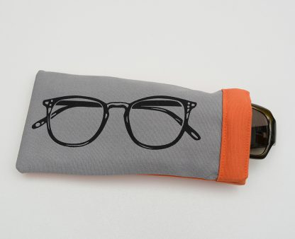 Grey glasses case with orange lining