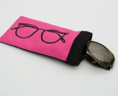 Pink glasses case with black lining