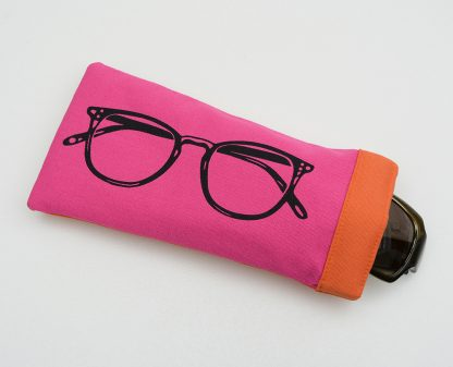 Pink screen printed glasses case with orange lining