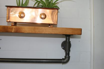 towel rail with rustic wooden shelf for British craft house