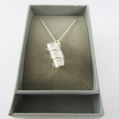 silver stamped spiral necklace