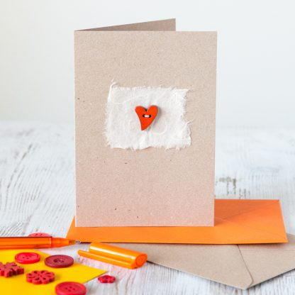 hand sewn wooden heart on mulberry paper greetings card