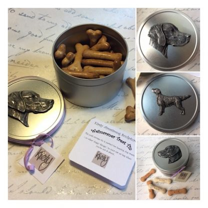 dog treat tins with sculpted reliefs of dogs cast in metal