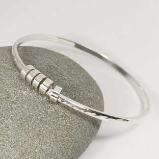 silver hammered bangle with charms