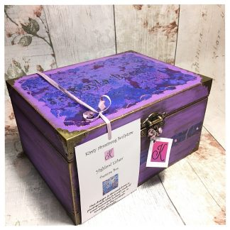 Large purple wooden treasure or keepsake box with decorated lichen print and metal corners