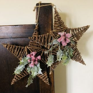 Rattan hanging star decorated with holly