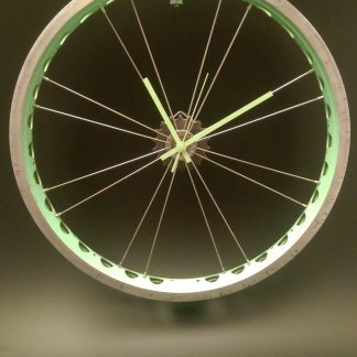 Drilled green bicycle wheel clock