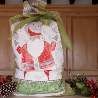 Shows Christmas Sack with Father Christmas on the front.