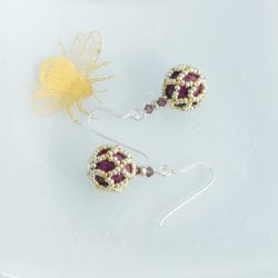 Purple beaded ball earrings
