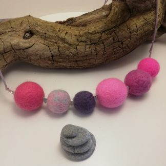 necklace made with pink wool balls
