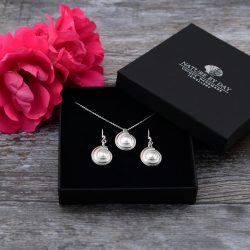 Tiny sundial shell necklace and earrings in box