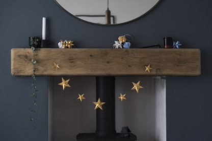 gold origami star garland on fireplace