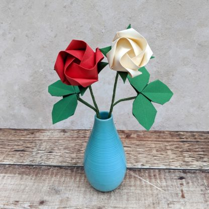red and white origami roses in vase