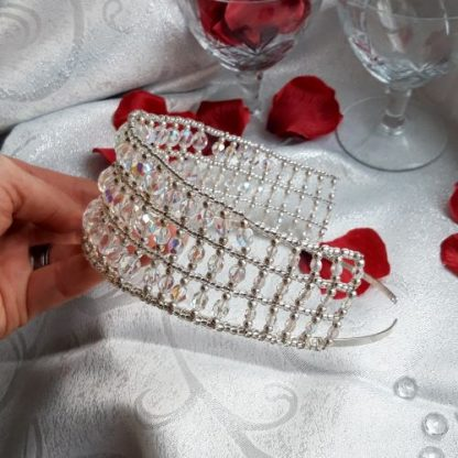 silver and crystal tiara held in hand