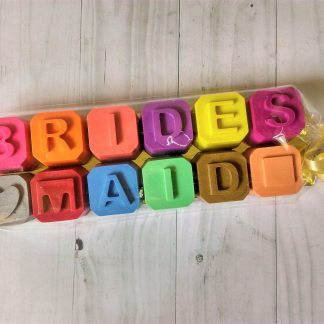 Wax crayons spelling out Bridesmaid for childrens wedding favours