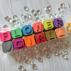 wax crayons spelling out flower girl for a wedding favour