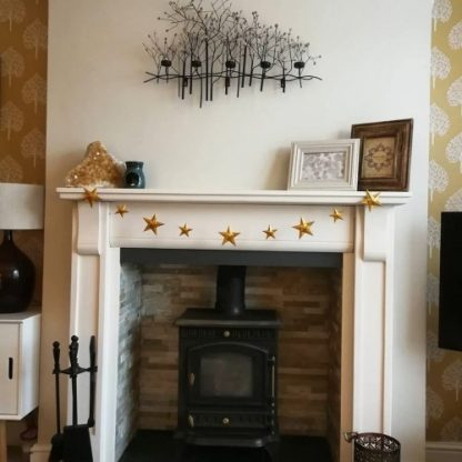 star garland on fireplace