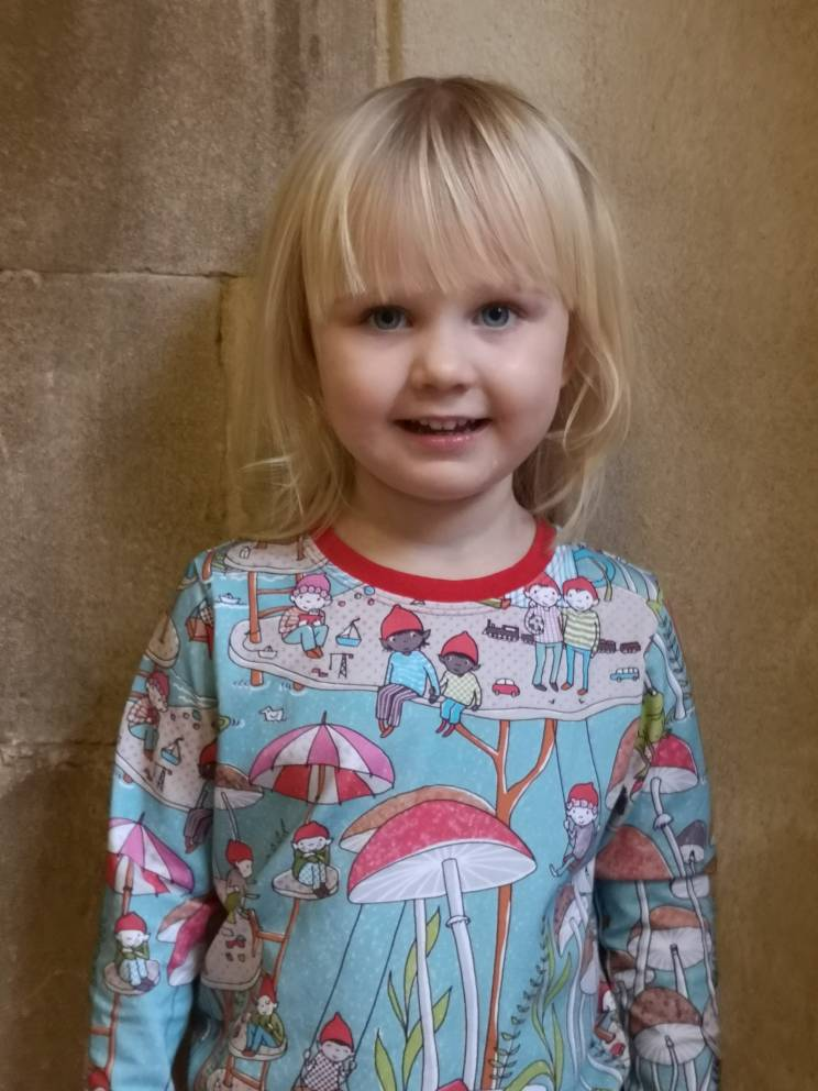 girl in toadstool and imp t shirt