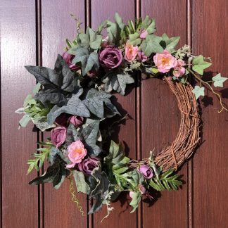 Pink roses and ivy on a front door wreath