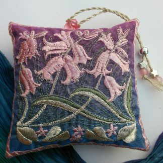 Bluebell flowers and its leave intertwine on this lavender bag design with pretty soft pinks and silver on blue
