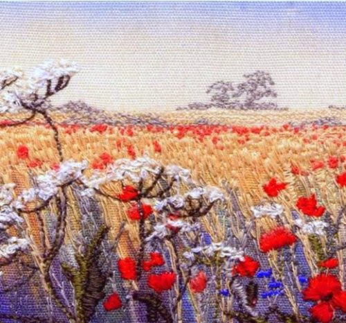 Embroidered picture of a cornfield and poppies