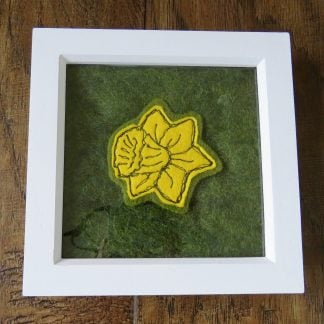 Daffodil free motion embroidered felt brooch on a handmade needle felt background. framed as a painting. Louise Hancox Textile Artist