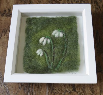 Showing a handmade needle felt painting. 'Snowdrops' by Louise Hancox Textile Artist