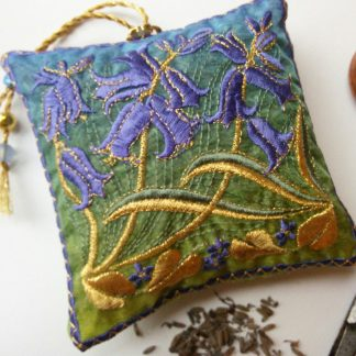 Woodland Bluebells embroidered on front of a lavender bag with beaded hanging loop in blues green and gold.