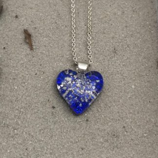 Handmade dichroic glass heart shaped pendant incorporating sand from Cornwall