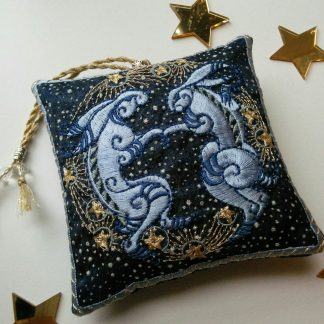 starry blue fabric lavender bag embroidered with a pair of blue MARCH HARES as a lavender pouch by Pauline Thomas