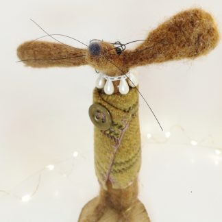 wool sculpture of a hare looking like an old lady character wearing tweed and a necklace