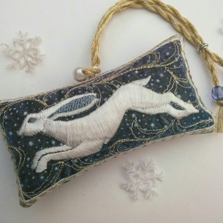 white running hare on a snowy fabric for a lavender bag gift lavender bag