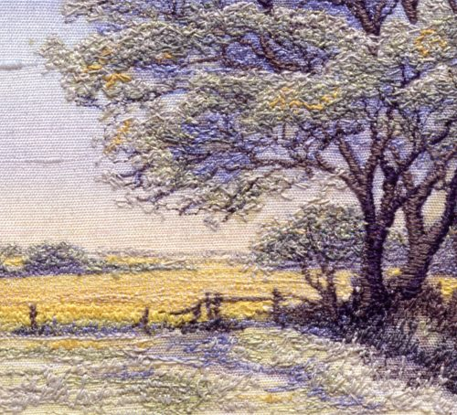 embroidered picture of a yellow spring landscape of oil seed rape and trees