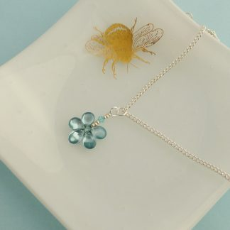 aqua blue flower pendant on a chain