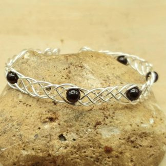 adjustable garnet wire wrap bracelet,dark red gemstone bracelet,empowered crystals,January birthstone,silver cuff bracelet,womens bracelet