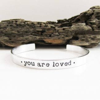 you are loved hand stamped aluminium cuff bracelet