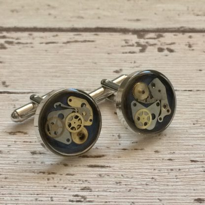 Rhodium plated steampunk cuff links featuring vintage recycled watch parts