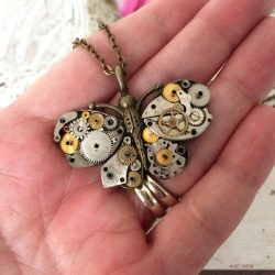 Handmade steampunk butterfly necklace featuring vintage upcycled watch parts