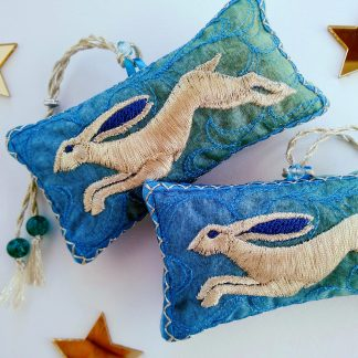 Golden Hare embroidery on two lavender bags in lovely summery blue rainbow fabric