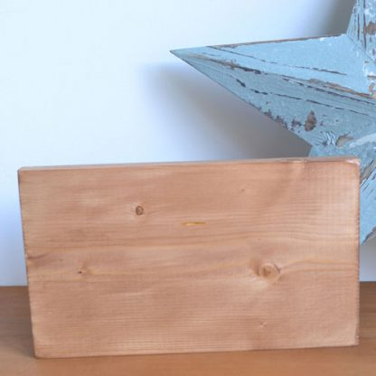 Wooden rectangle stood next to a star and on a shelf